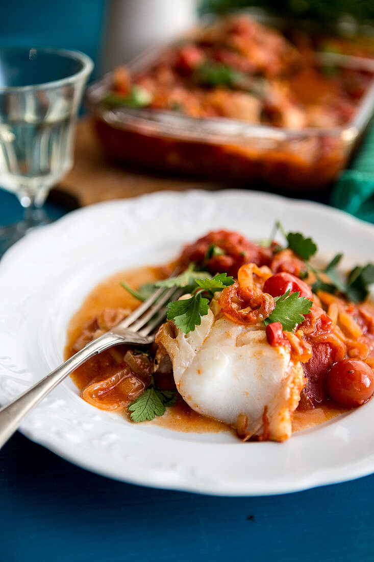 Oven-baked fish with a mustard and tomato sauce