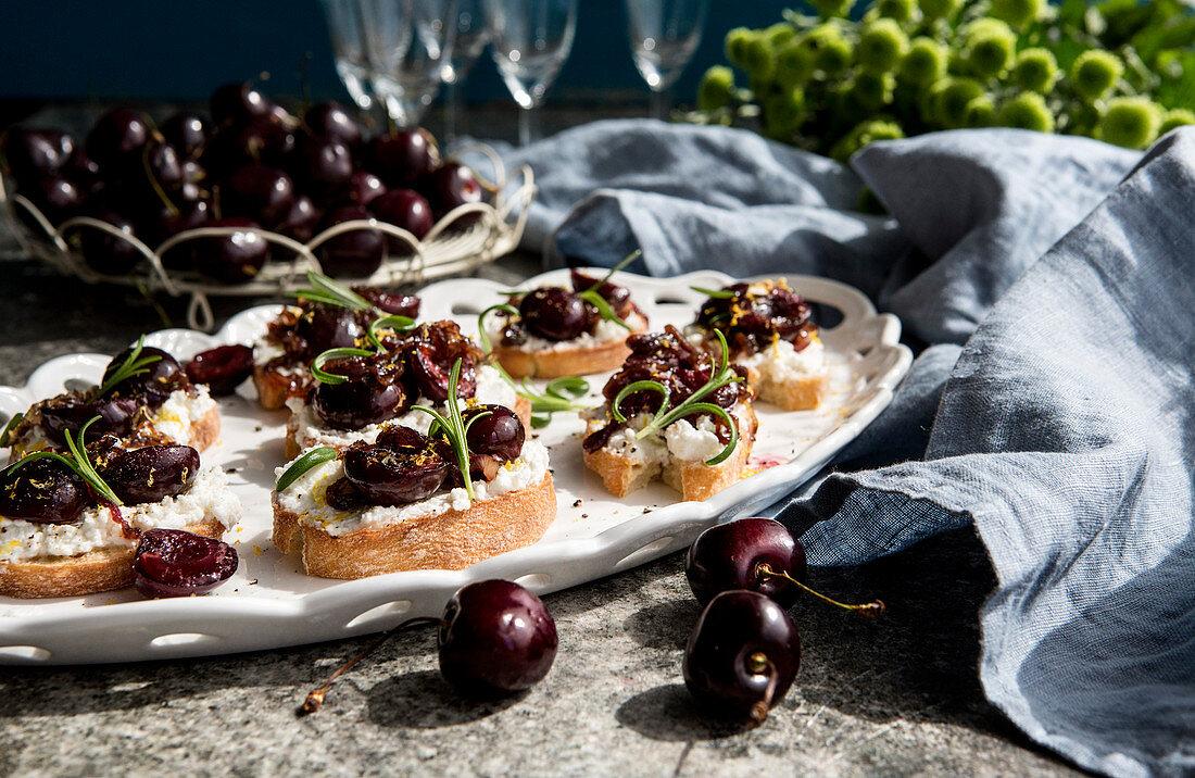 Crostini with ricotta, rosemary and balsamic cherries