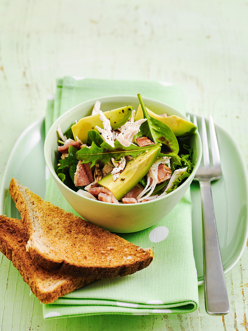 Warm chicken and avocado salad with pancetta rocket and baby spinach served with toast
