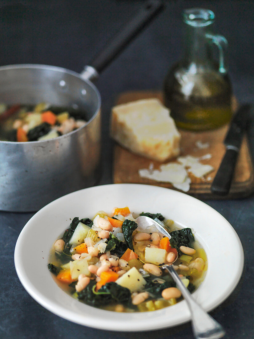 Italian Cavalo Nero Bean and vegetable soup, served with pamesan cheese
