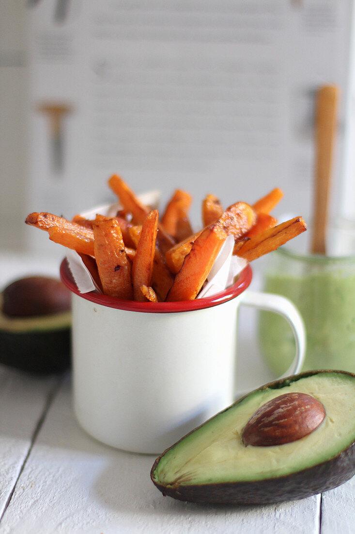 Sweet potato fritters in an enamel mug with an avocado dip