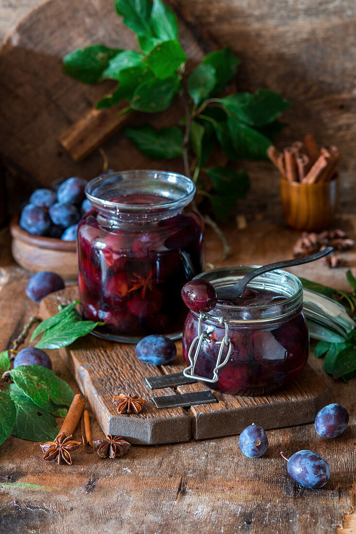 Pickled plums with spices in sugar syrup