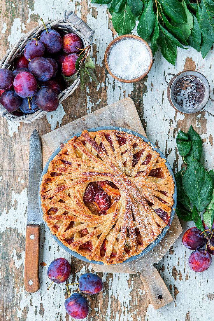Plum pie with spiral design crust