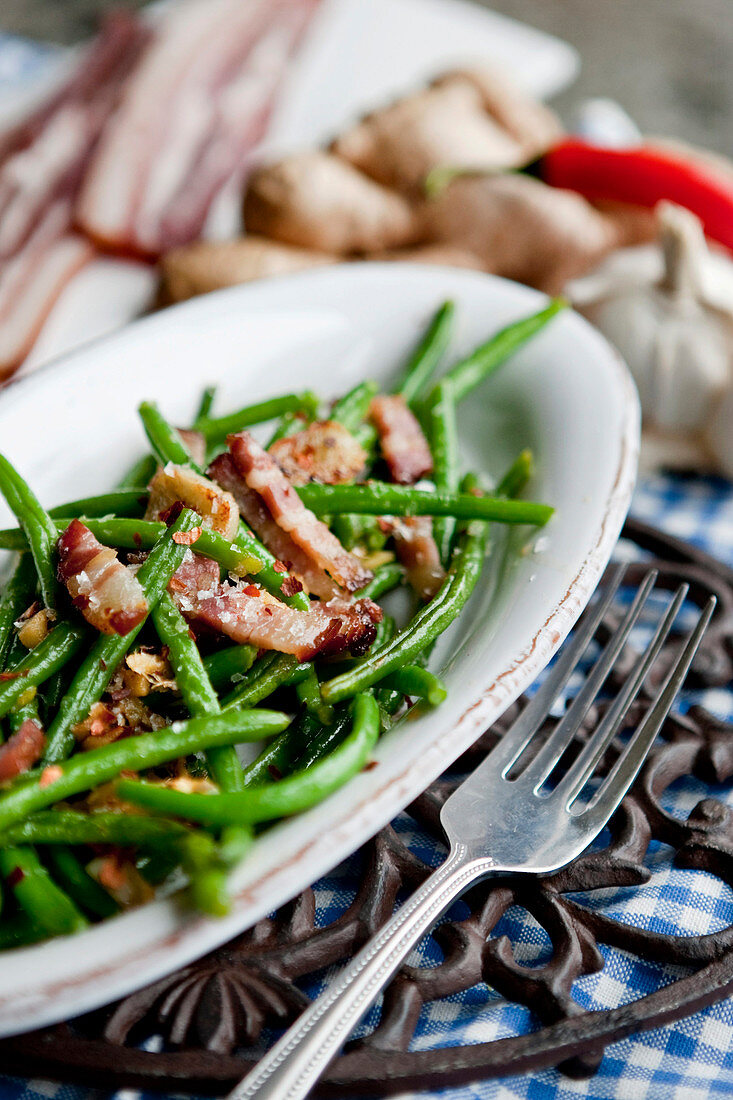 Roasted green beans with gingerbread spice and bacon