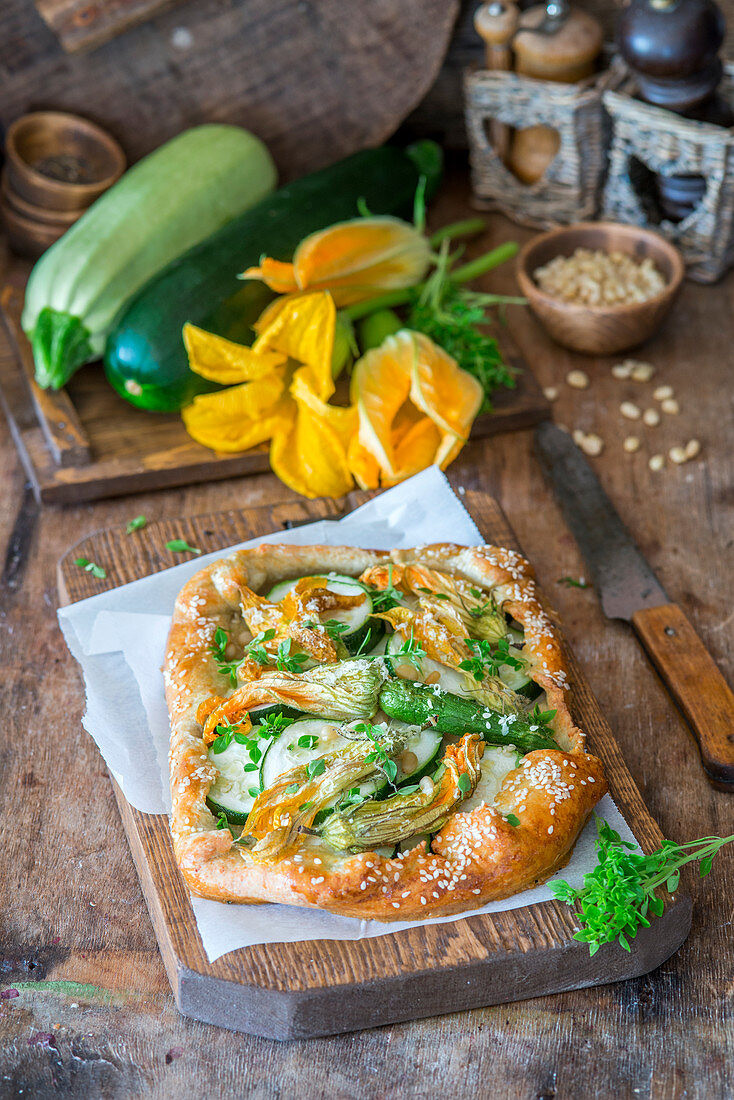 Zucchini flower pie with pine nuts