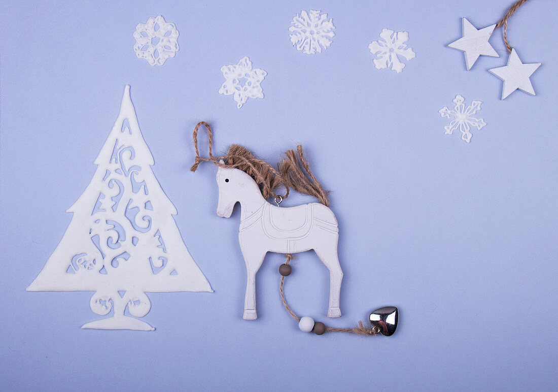 Sweet Christmas tree made of icing, wooden hors, icing snowflakes