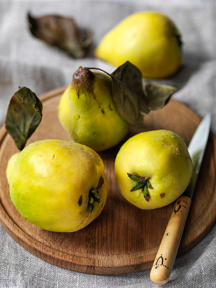 Quinces on board with knife