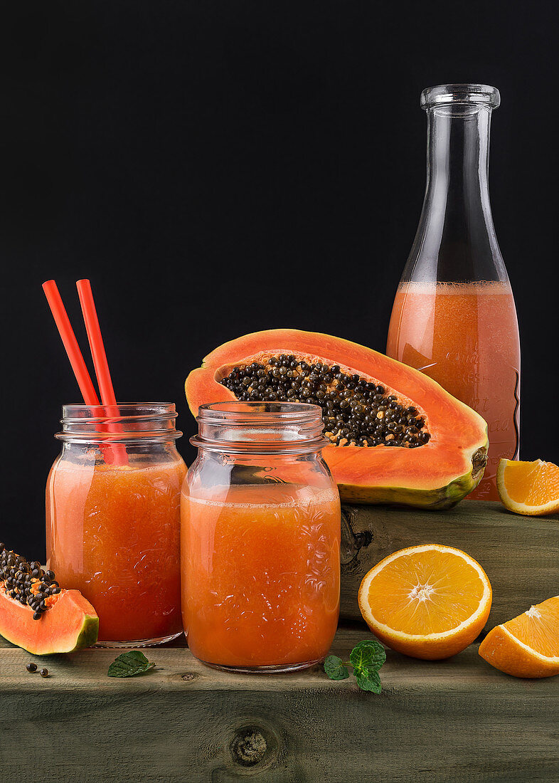 Colorful orange and pawpaw drink served in drinking jars