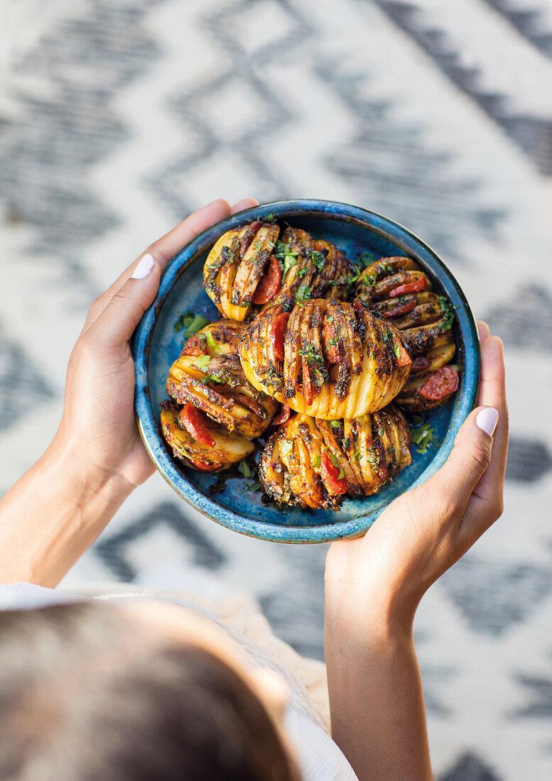 Hasselback potatoes with chorizo and herbs