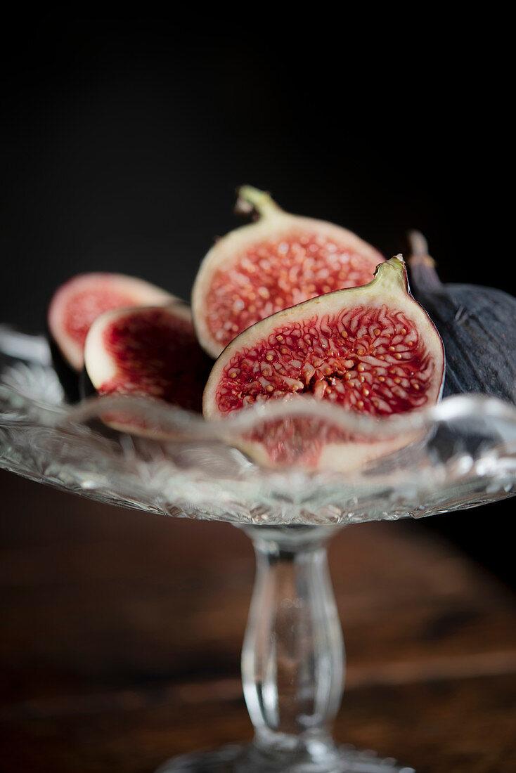 Freshly cut figs in a glass bowl