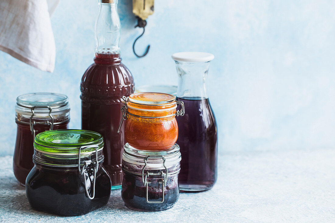 Jars of various homemade jams and beverages