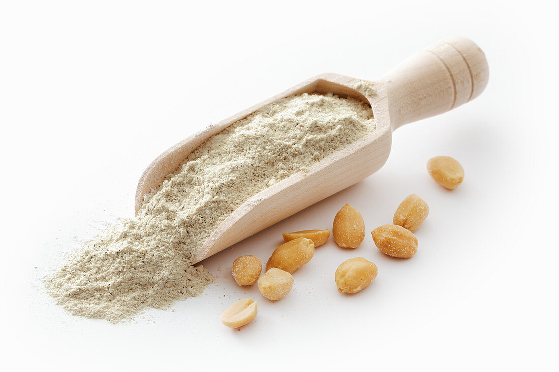 Peanut flour on a wooden scoop