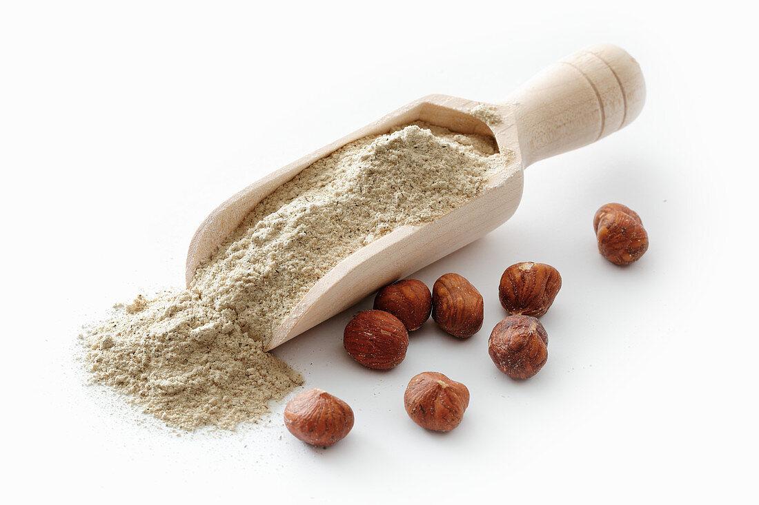 Hazelnut flour in a wooden scoop