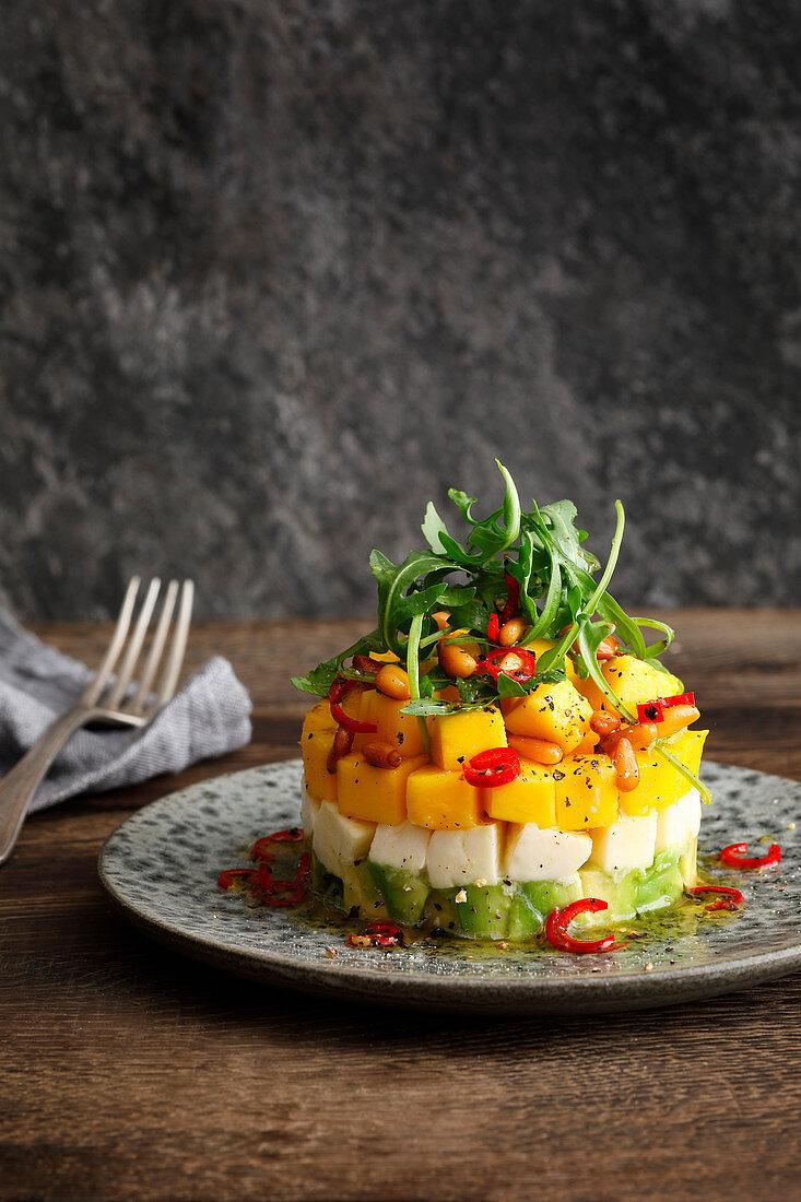 Mango, mozzarella, and avocado salad with acacia honey