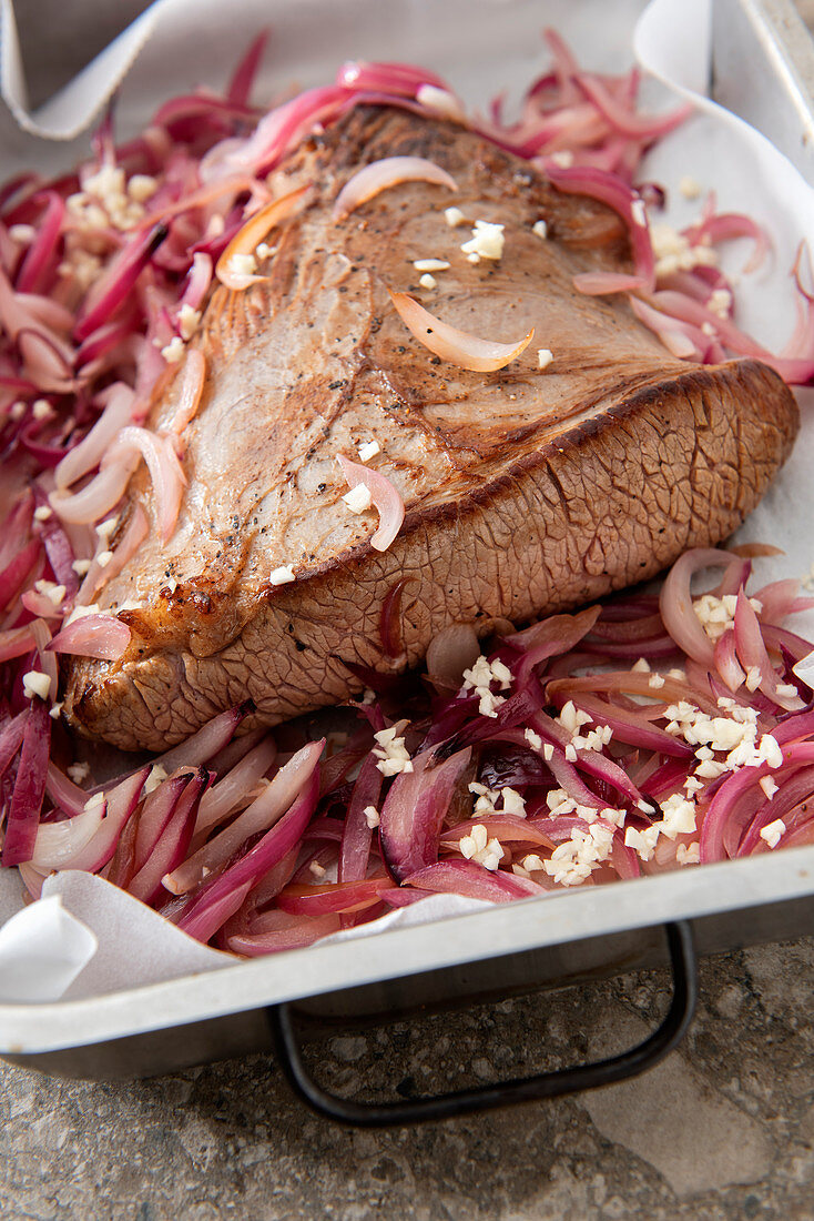 Slowly braised beef breast with caramelized red onions
