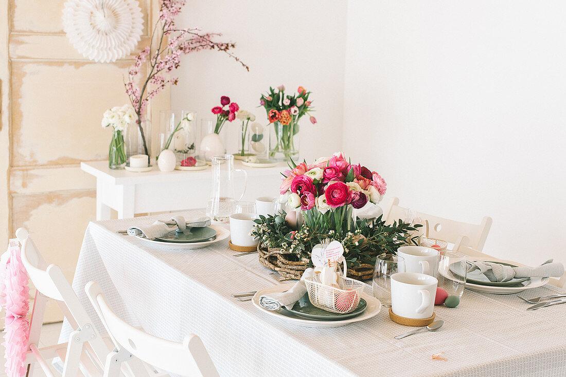Flower arrangements on table set for Easter