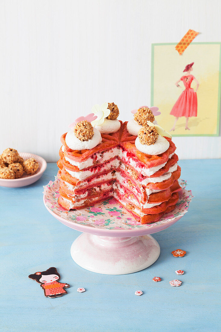 Red waffle cake with raspberry and hazelnut filling
