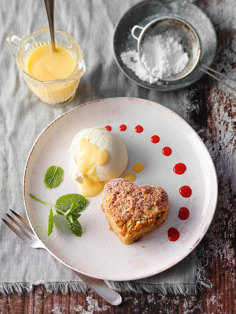 Warm apple cake with eggnog ice cream with redcurrant sauce