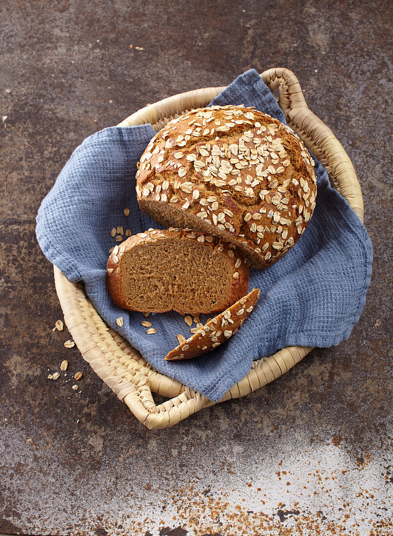 Bread baked in a cast iron pot with malt syrup and oats