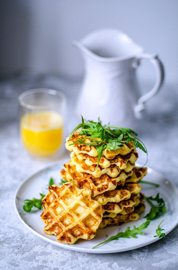 Belgian waffles, made from potato dough with arugula and fresh orange juice