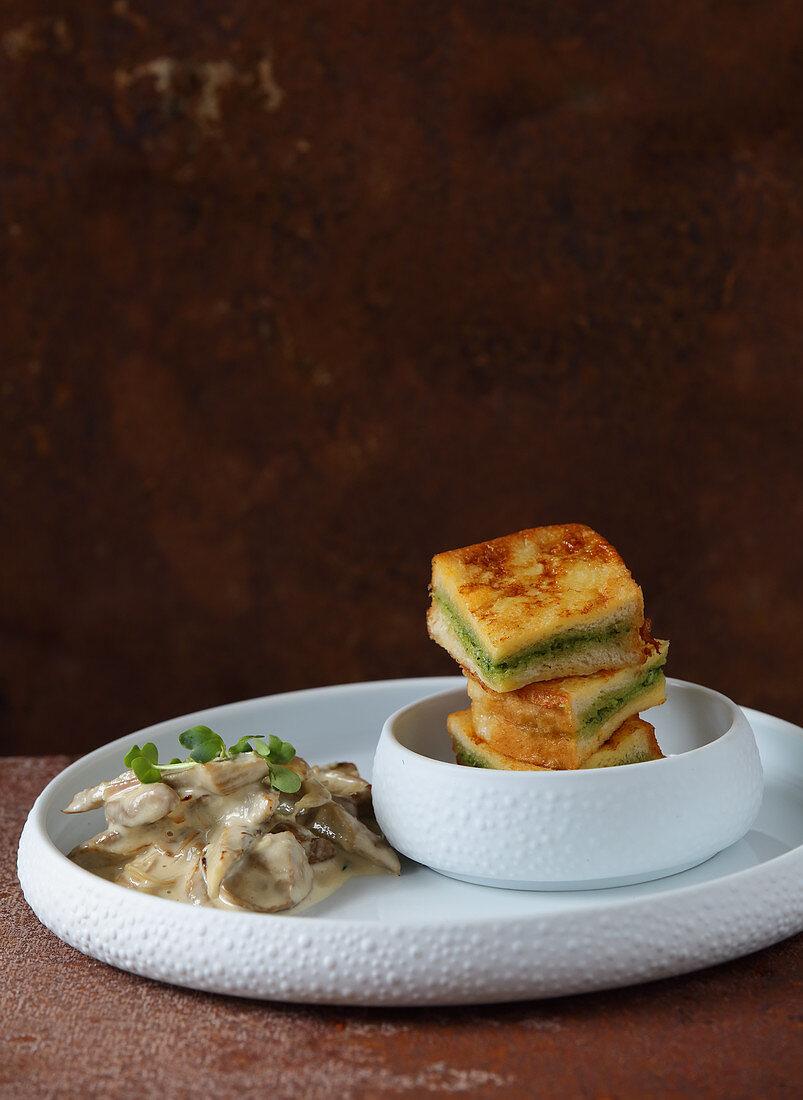 Savoury French toast with pesto and creamy mushrooms