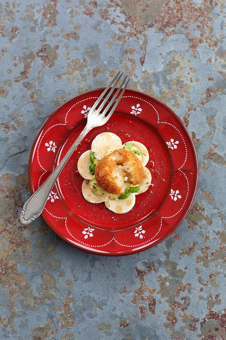 Risotto dumpling on a mushroom carpaccio and cheese mayonnaise