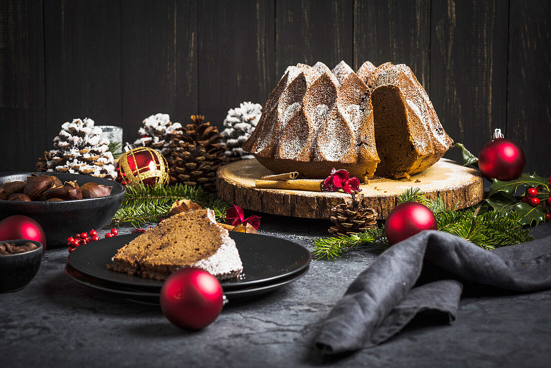 Christmas chestnut and chocolate cake on a tree bark disc