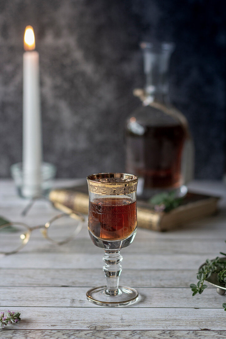 Herbal liqueur in a glass with a golden rim