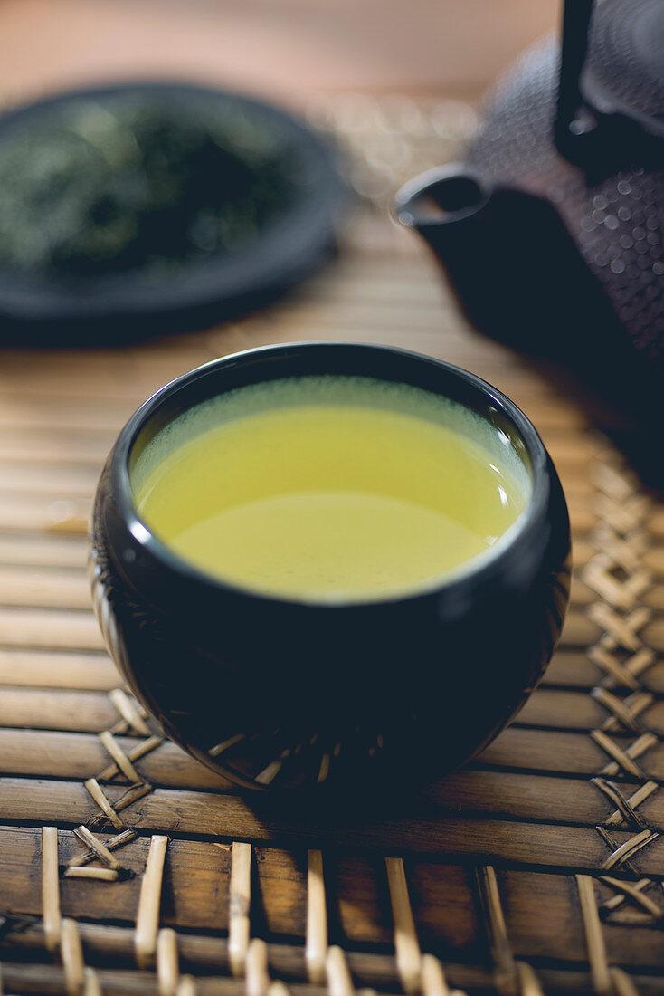 Green tea in a tea mug