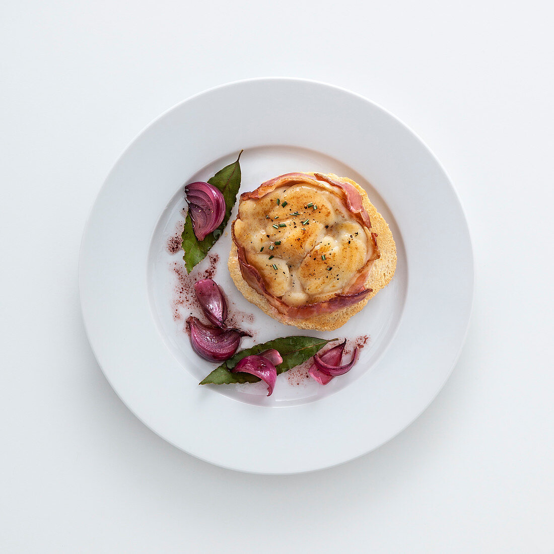 Champagne and saffron monk fish with bacon on toast