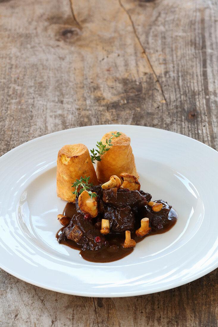Venison goulash with chanterelle mushrooms and a potato souffle