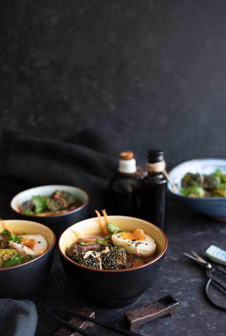 Savoy cabbage rolls in ramen soup