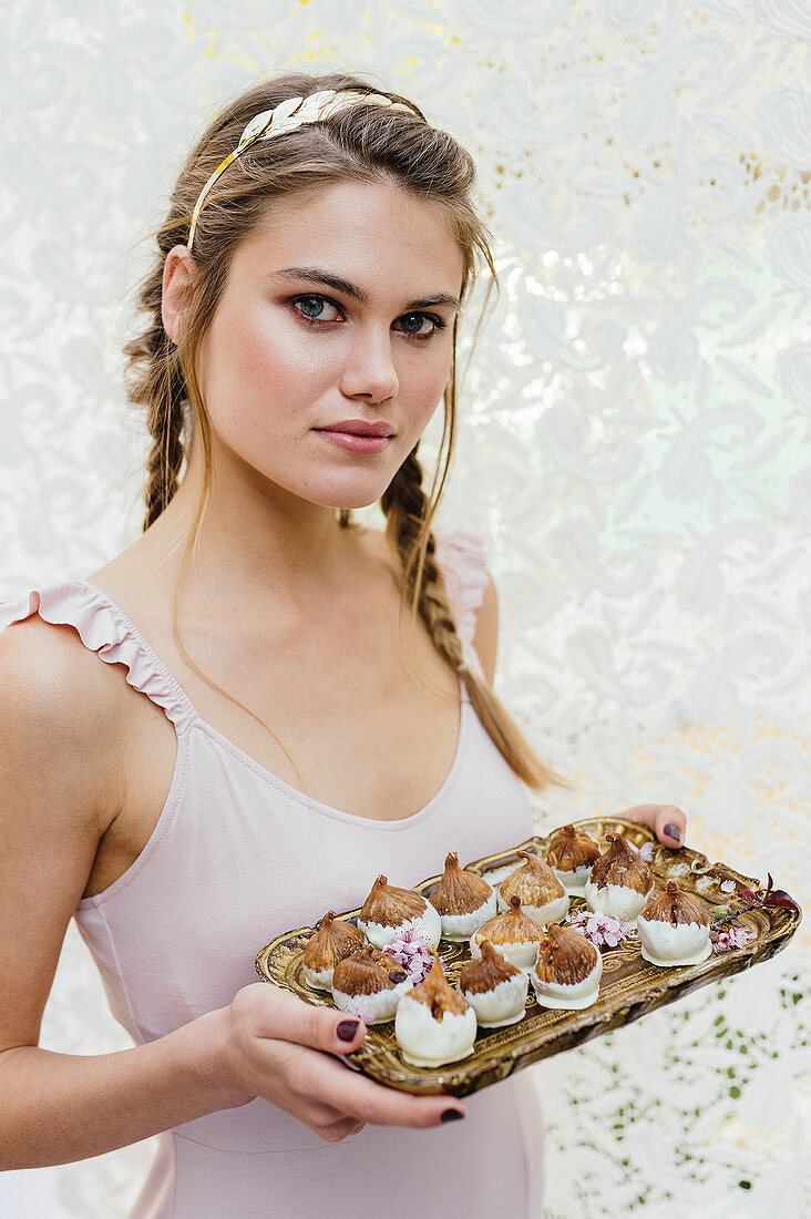 A young woman with chocolate figs