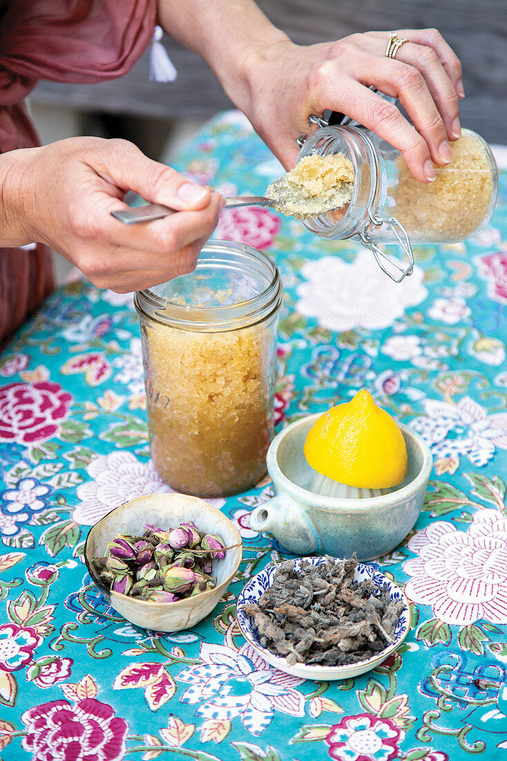 Honey, brown sugar and dried flowers for making body scrubs
