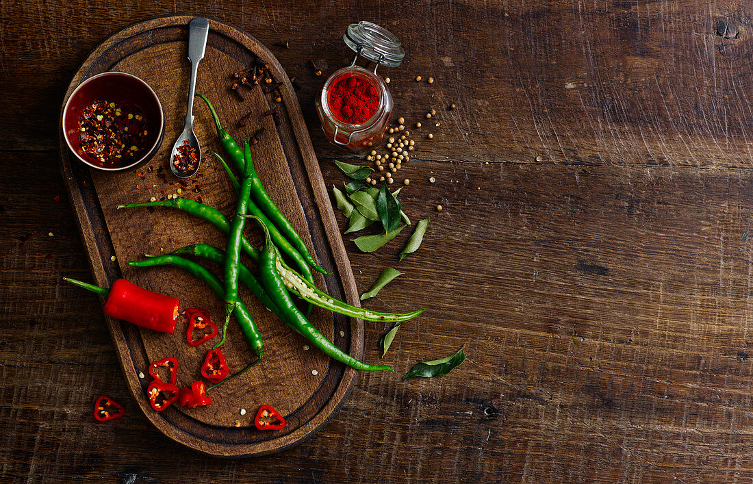 A spice still life with fresh chili peppers