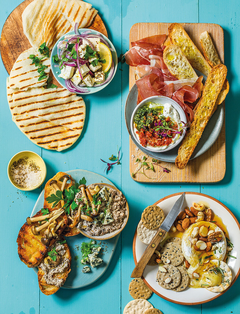 Party nibbles: Flavoured feta, Parma ham with ciabattas, molten camembert with nuts and mushroom bruschetta