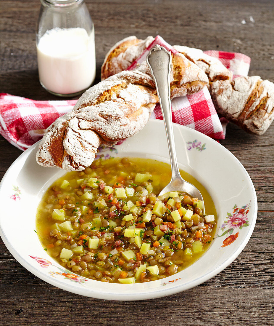 Palatine lentil soup with plate lentils, potatoes and bacon