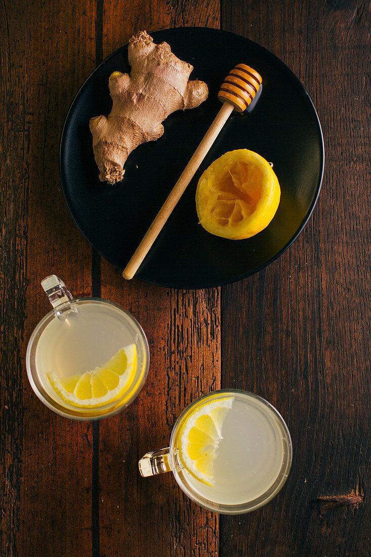 Preparing switchel with lemon juice, ginger and honey