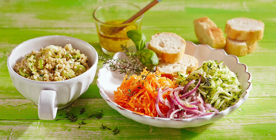 Quinoa salad with grated vegetables, baguette slices, and a herb vinaigrette