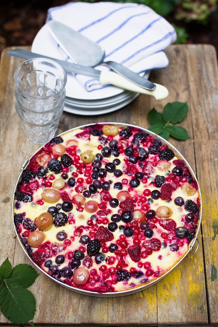 Summer berry cake with sour cream for a picnic or beer garden