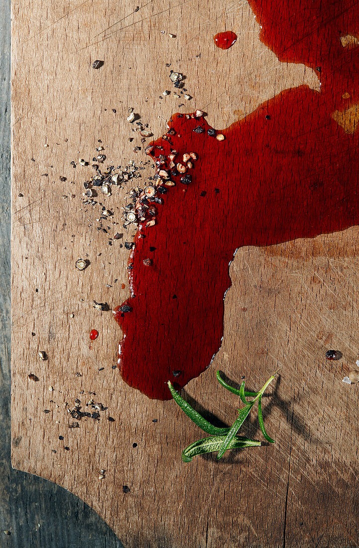 Blood on a wooden cutting board (top view)