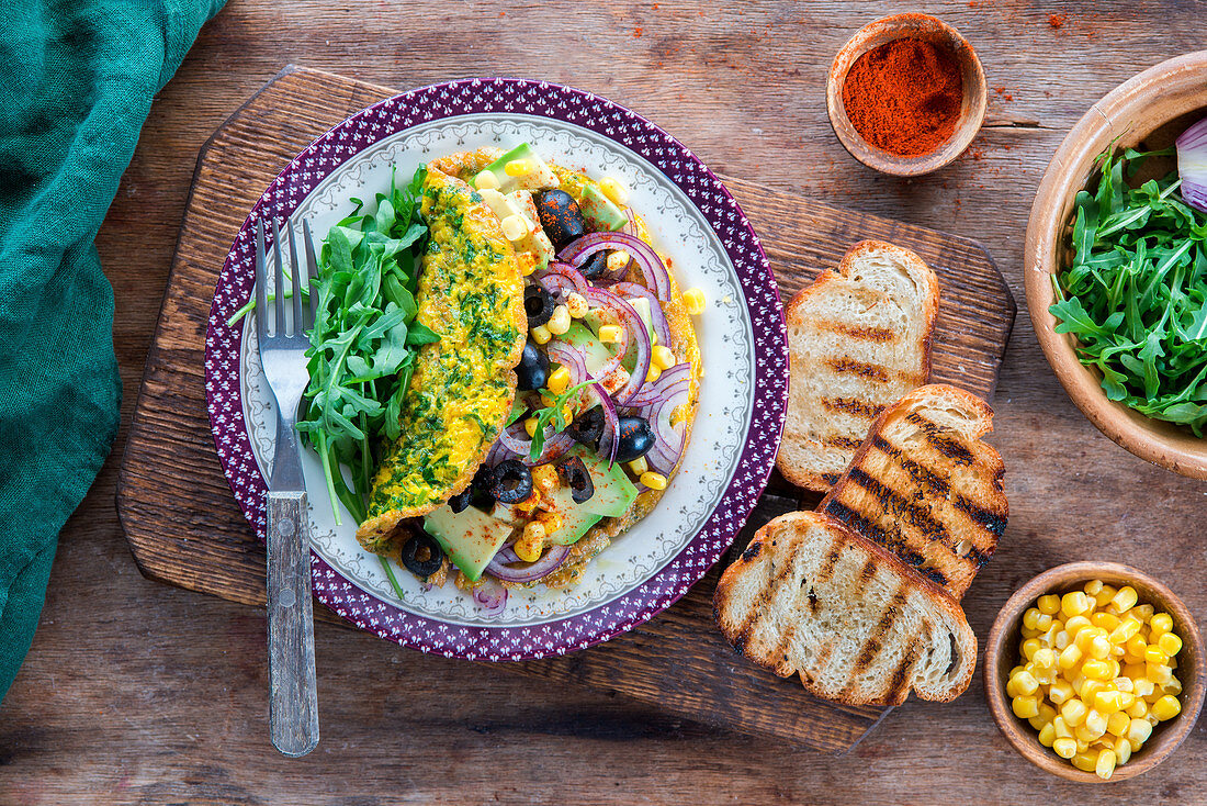 Omelete with avocado, onion, olives