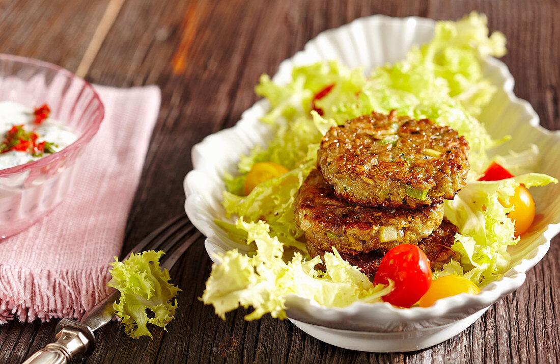 Vegetarian spelt patties on frisee salad