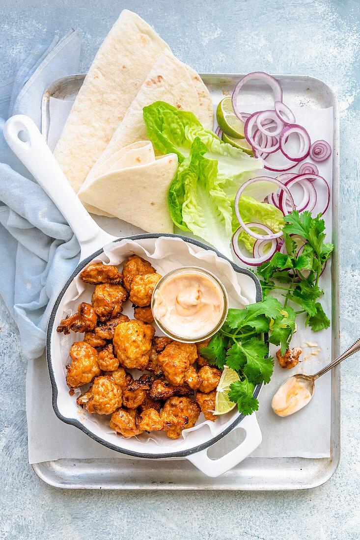 Fried cauliflower bites with a dip