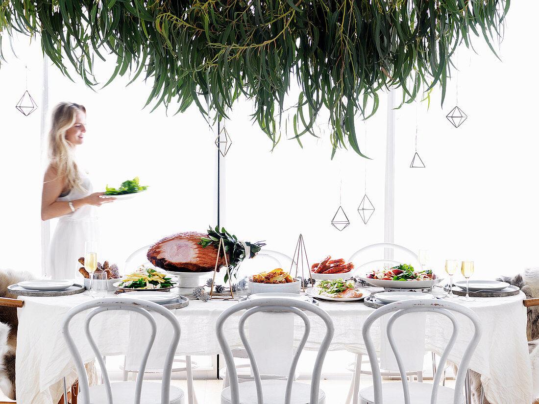 Woman serving menu on a Christmas table