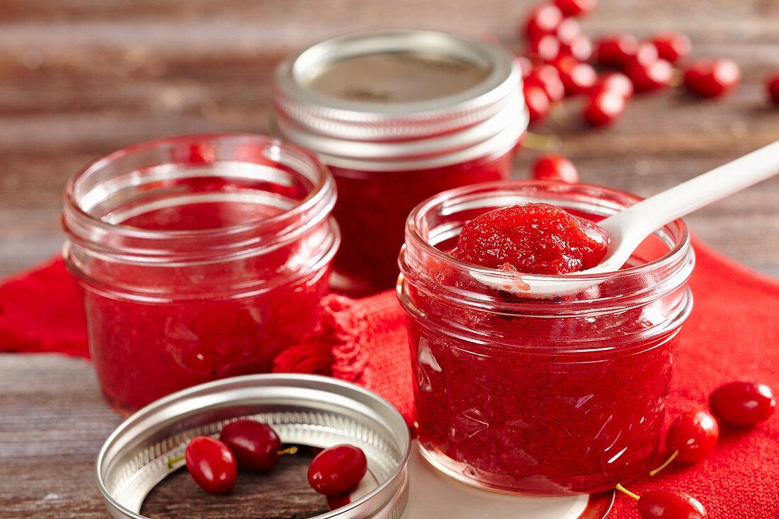 Homemade cornelian cherry and vanilla jam in a mason jar