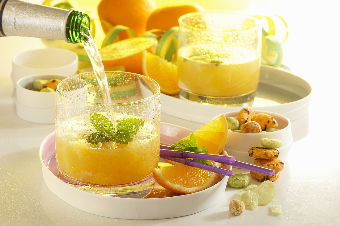 Orange punch with white rum, champagne and pineapple juice
