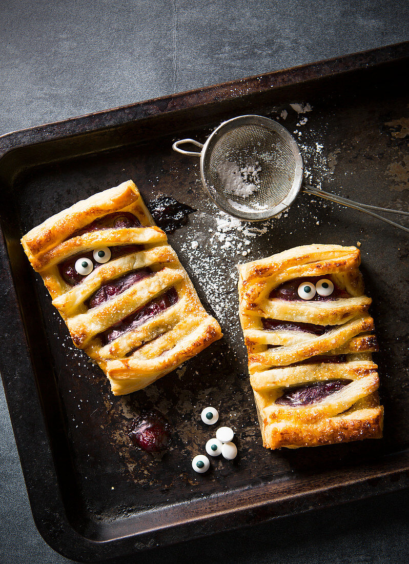 Halloween individual cherry pie mummies with edible eyes
