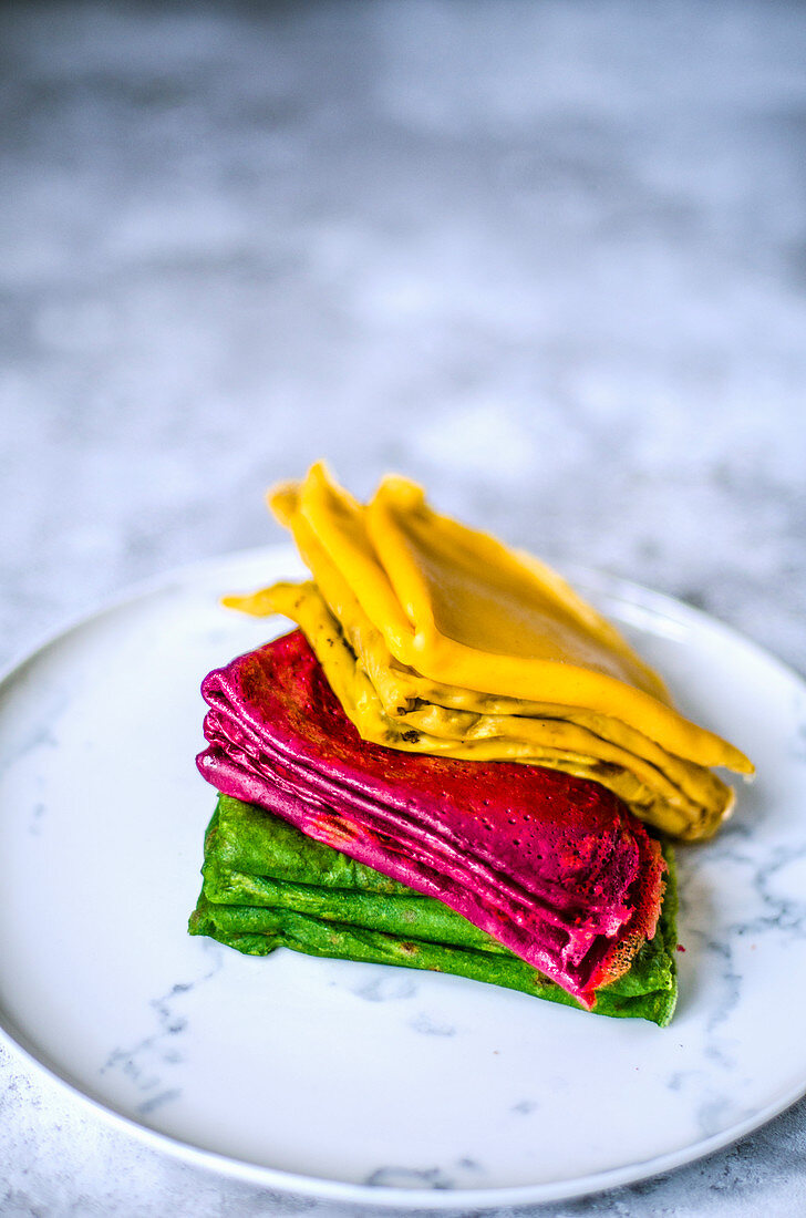 Thin pancakes with carrot and beet juice