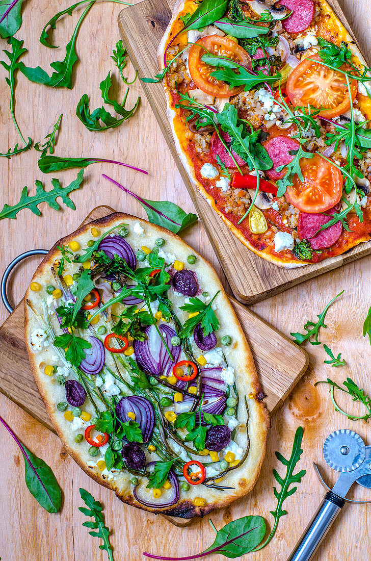 Two colourful pizza